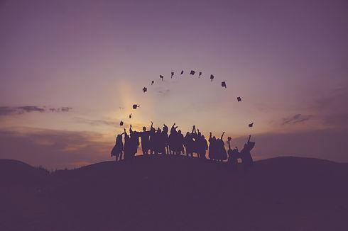 Canva - Silhouette of Graduates on a Hil