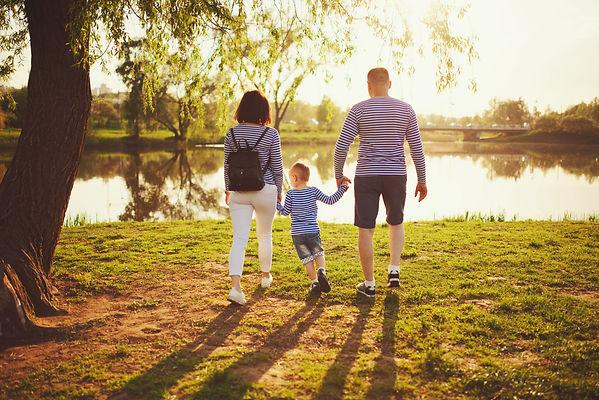happy-family-in-summer-park-H4X26JY.jpg