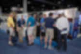 Dealer attendees at Dealer Week gathered around the Kenect booth.