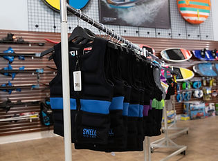 Rack of blue and black lifejackets in a dealership.jpg