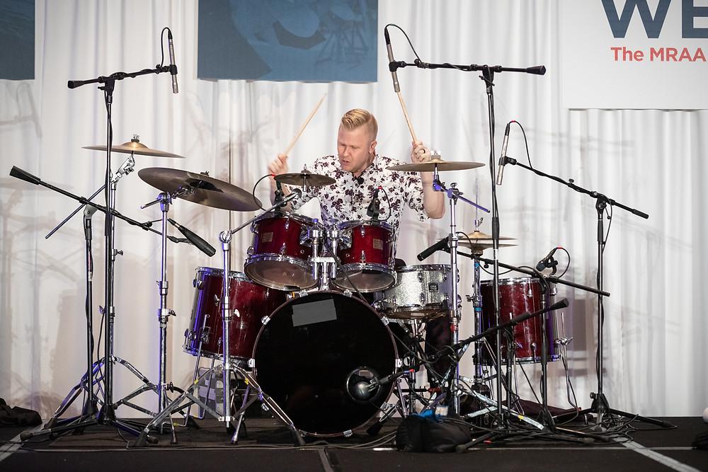 Here is Dealer Week's closing presentation, drummer and inspirational speaker Clint Pulver.
