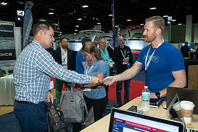MotoTV, a vendor at Dealer Week interacts with a dealer.