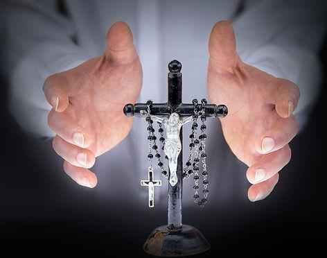 rosary-black-crucifix-hands-white-light-orig-1400.jpg