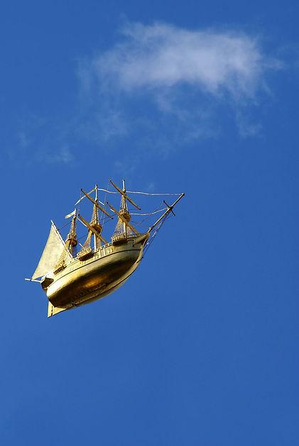 shap-sailing-along-blue-sky-1280.jpg