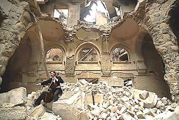 cellist-plays-in-midst-of-ruins.JPG
