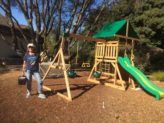 Tracey Assembling a Swing Set