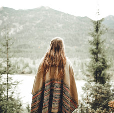 Canva - Woman Wearing Brown Poncho Facin