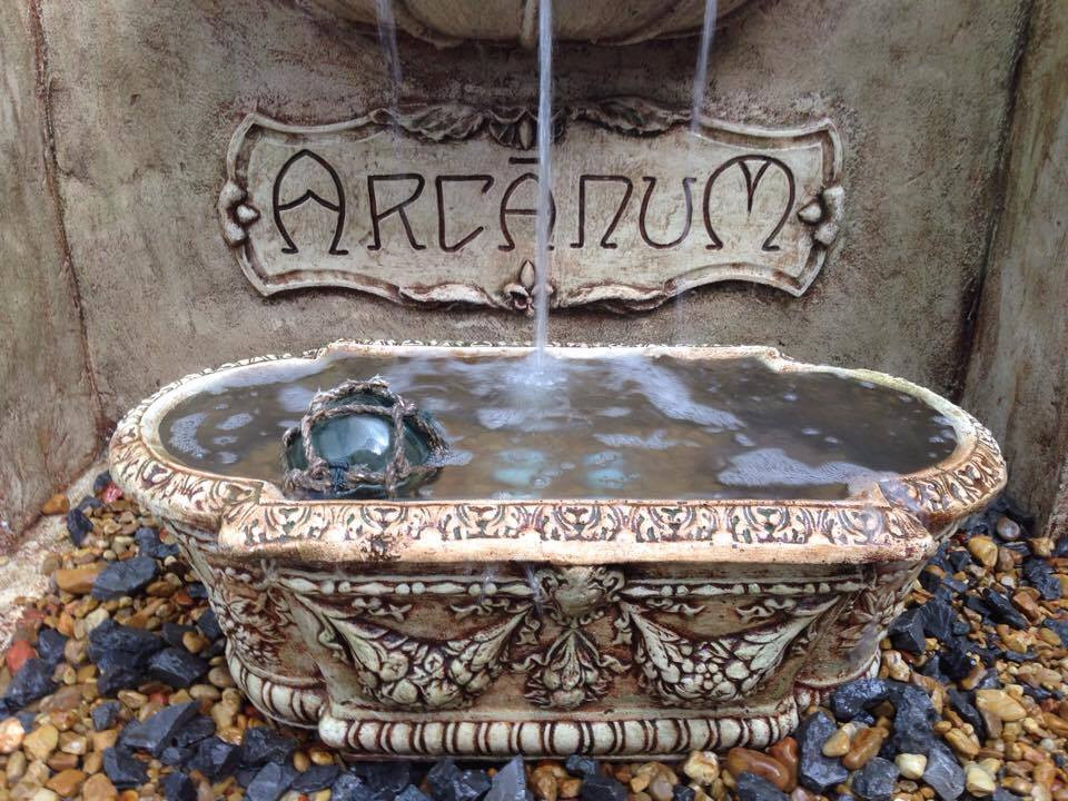 Detail showing the bottom trough basin and the Arcanum plaque