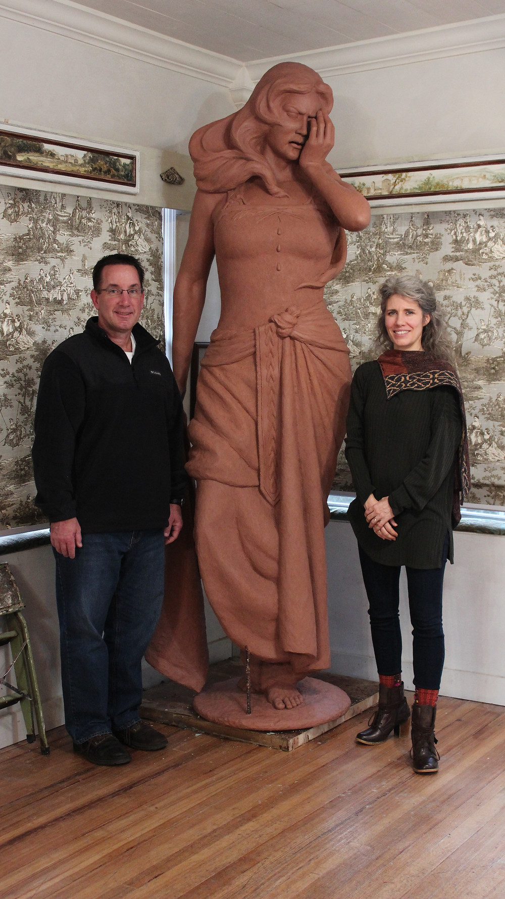 "Father John in my studio with the original clay sculpture of ""Rachel Weeping"""