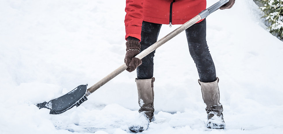 close-up-of-woman-shoveling-her-parking-