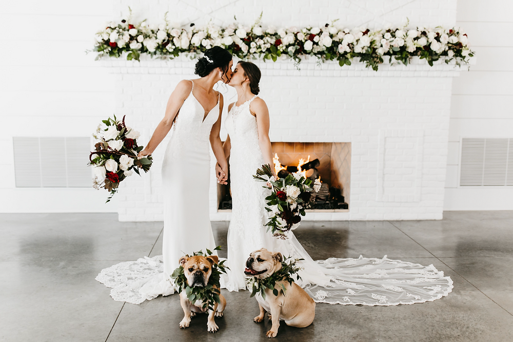 Lesbian Brides, Gay Wedding, Gay Brides, Bulldogs at Wedding, Pet at Wedding, Dog Wedding Photos, Kissing Brides, Fireplace, Wedding Venue, Hutton House, Bulldogs