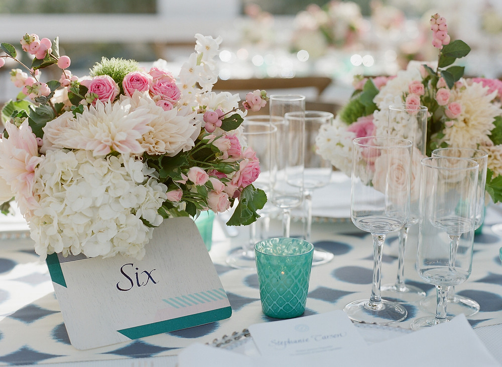 summer wedding decor, lakeside wedding decor, pink and white bouquet, pink and white flowers, pink and white arrangement, pink and white wedding flowers, tiffany blue, aqua wedding color, white and aqua wedding, wedding table, guest table, wine glasses, champagne flutes, aqua water glass, wedding centerpieces, blue and white tablecloth, place cards, table numbers