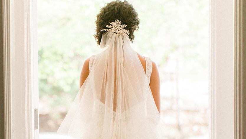 bride looking out window, bride's veil, bridal veil, hair accessory, bridal hair style