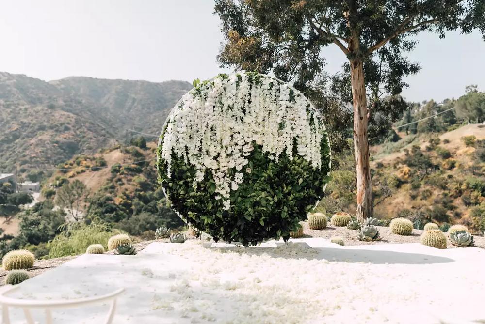 flower wall, circular floral wedding backdrop, floating flower arrangement