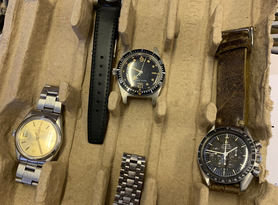 What a tray... From left to right: Vintage Rolex, Grand Seiko, Smiths Astral, JLC and Omega. What a collection of watches.