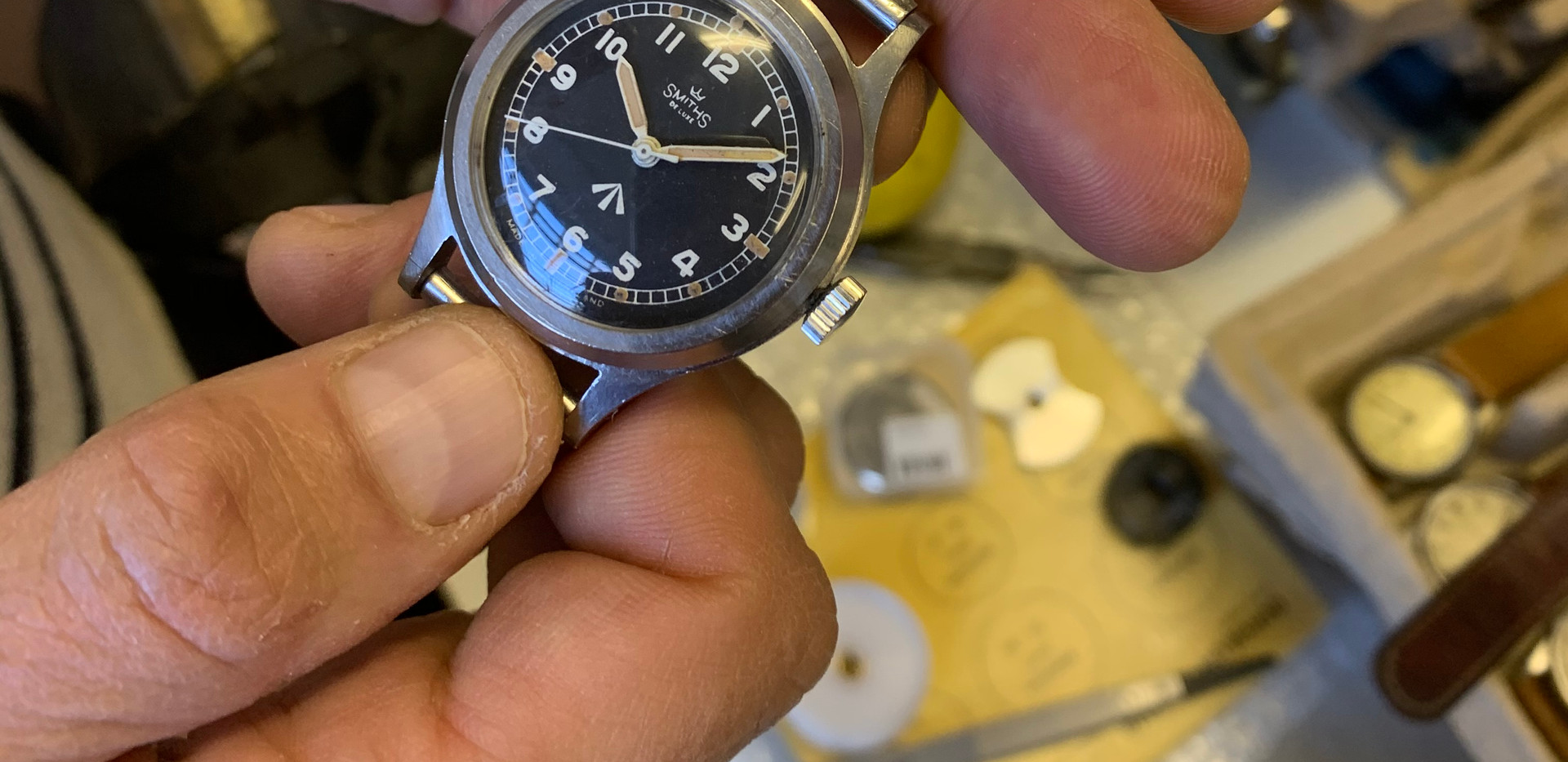 An amazing 40's Smiths De Lux military watch on its original bracelet.