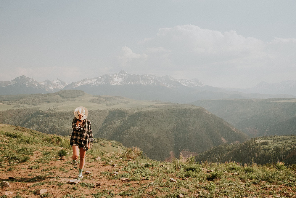 young woman hiking while living solo van life