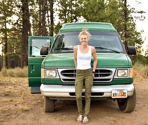 woman-standing-in-front-of-green-van.jpg