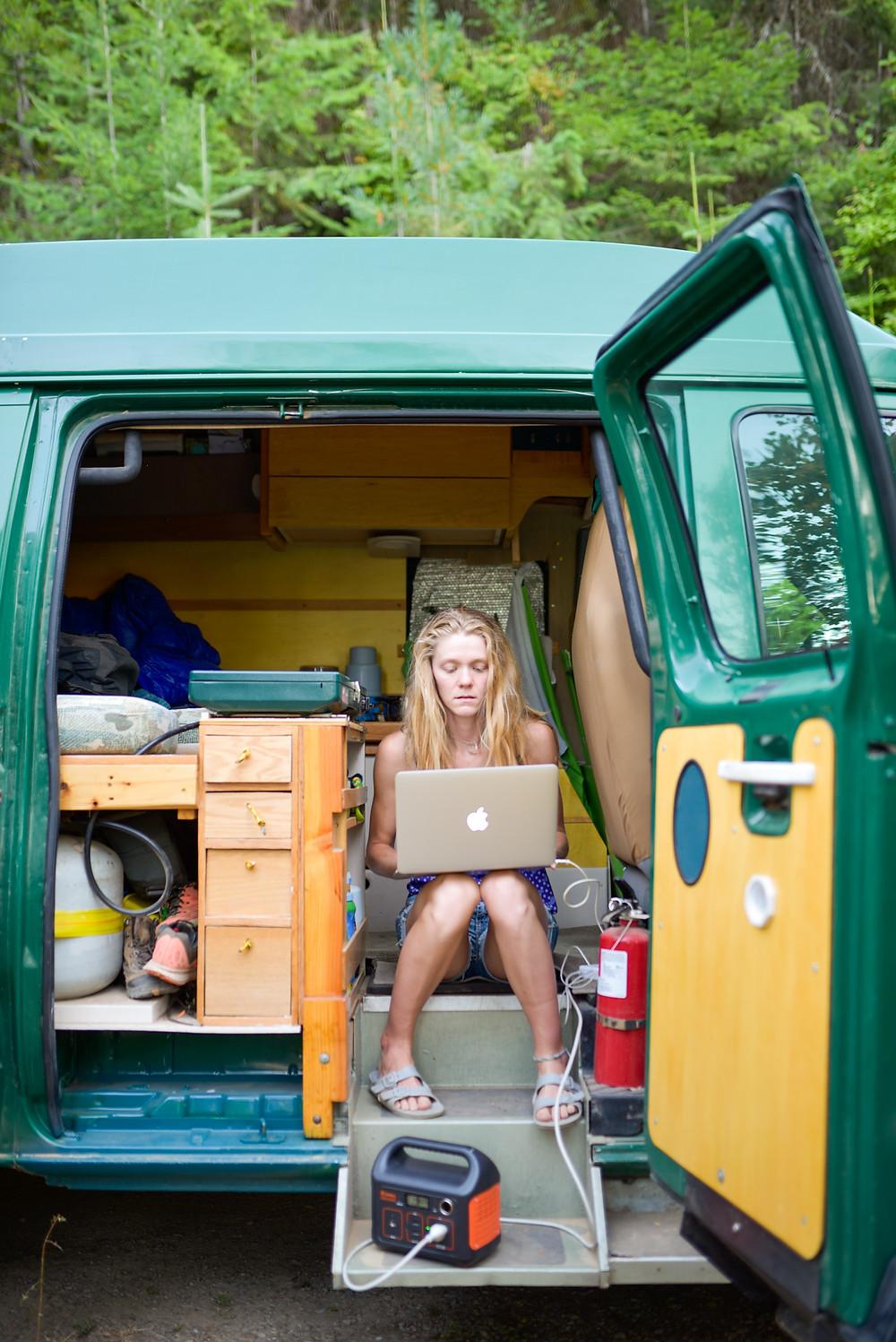 woman working on laptop inside van