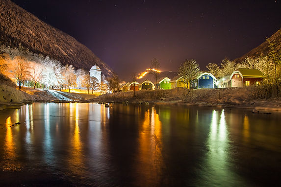 Cabins by the river at night