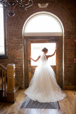 bride in front of door