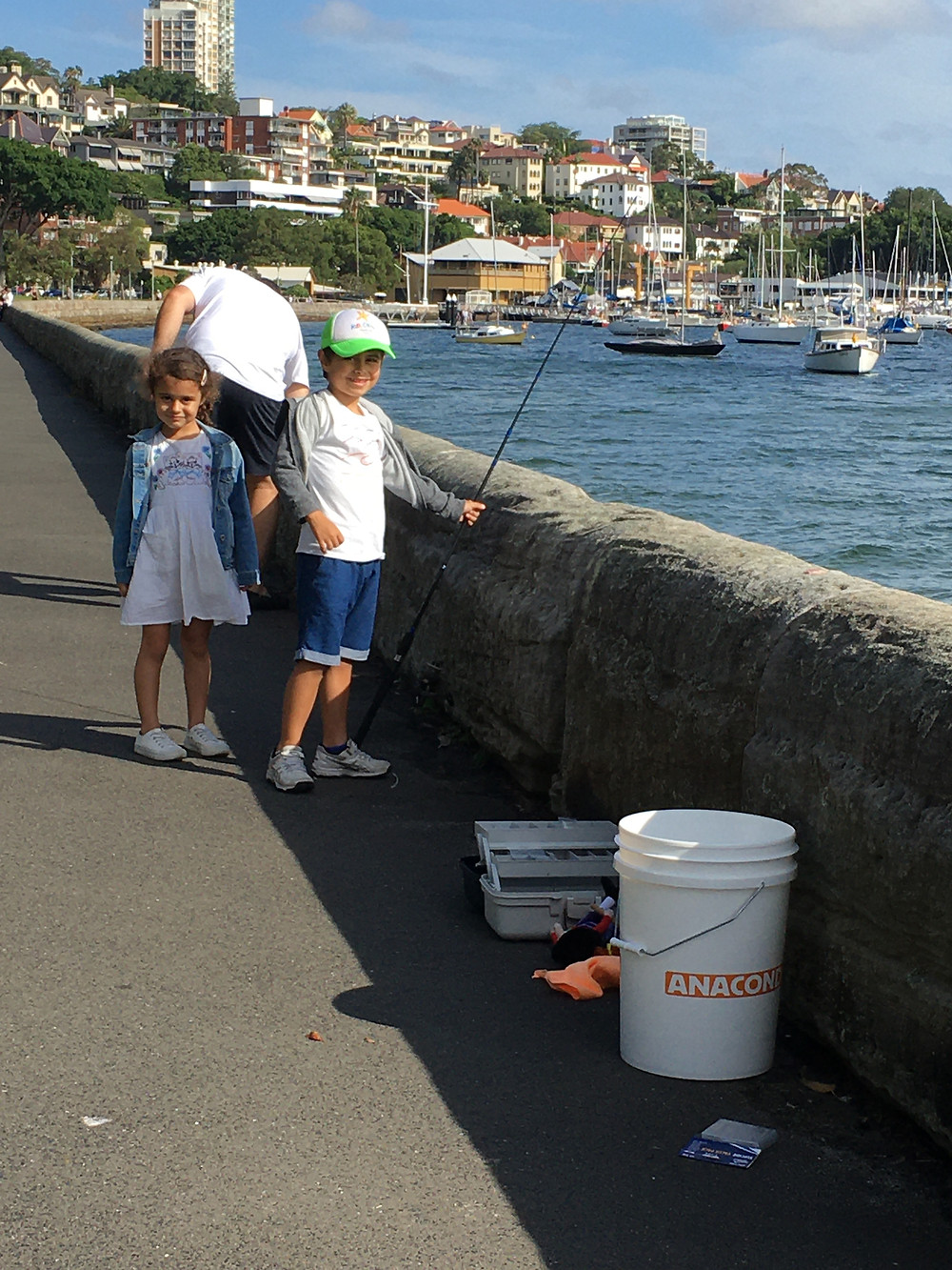 A father, son and daughter fishing by the Sea Wall