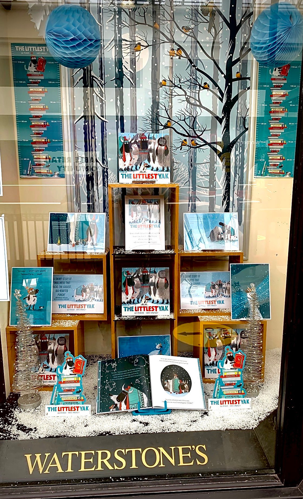 A branch of Waterstones with a window display of The Littlest Yak by Lu Fraser and Kate Hindley