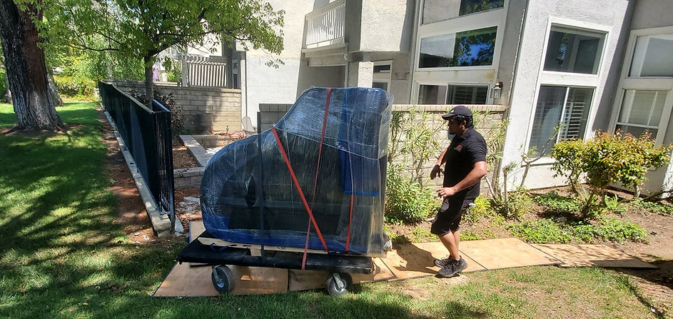 Piano Moving - All Terrain Piano Dolly - All Terrain Piano Moving - Los Angeles Piano Movers - Luna's Piano Movers - Orange County Piano Movers - Ventura County Piano Movers - Piano Storage - Los Angeles Piano Storage - Movving a piano through tough terrain