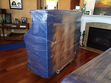 Luna's Piano Moving & Storage - Wrapping and upright piano the right way - Luna's Piano Movers - Luna's Moving Company