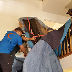 Moving a grand piano down a curved staircase. Hire the best piano movers to move your piano. Luna's Piano Moving & Storage will get the job done right! Orange County Piano Moving.