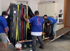 Luna's Piano Movers finish move the concert grand piano down the ramp. San Diego Piano Moving Company