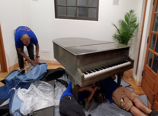 Baby Grand Piano - Going up!