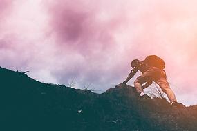 silhouette-man-climbing-steep-mountain-g