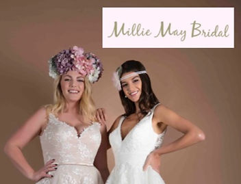 Two-Women-in-wedding-dresses-with-flowers-in-their-hair
