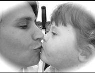 mum-daughter-kissing
