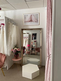 Mollydollys-boutique-mirror-and-curtain-with-flowers-on-a-table