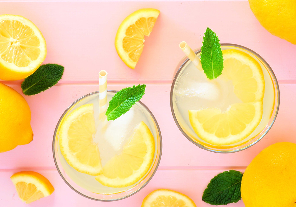 A top-down photo of two glasses of fresh lemonade