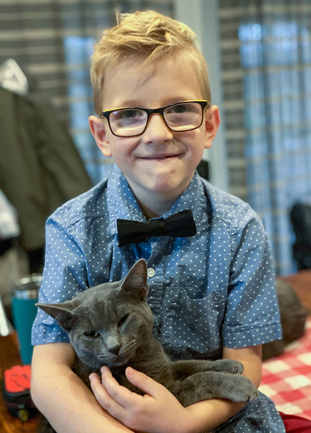 A picture of my son, Charles, with his cat.