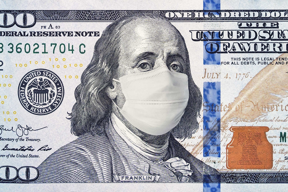 An image of a $100 bill with Benjamin Franklin wearing an N95 face mask.