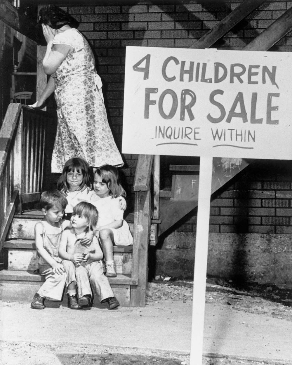 """historic photo, black and white, sign in yard reads """"4 children for sale - inquire within'"""