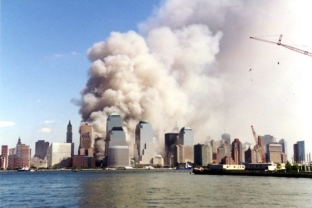 A photo of smoke rising from the NYC skyline after the collapse of the twin towers on September 11, 2001 by Wally Gobetz