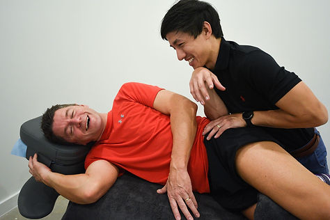 Physiotherapist Timothy/Tim Tey using elbow to release muscle tension
