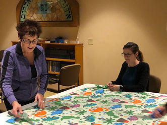 Women making a blanket for charity