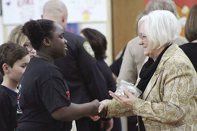 Mayor-Kathi-Hemken-congratulates-Robbins