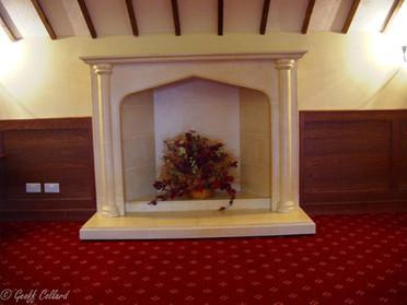 Hidden cupboard behind a fireplace