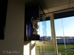 Trophy Cabinet with rugby ground in the background