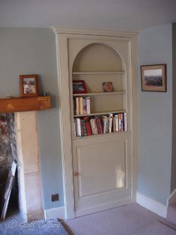 Arched secret bookcase door bathampton