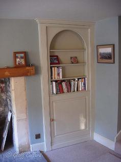 Alcove bookcase with hidden door