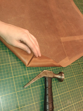 PAIR OF RE-UPHOLSTERED LEATHER BAR STOOLS