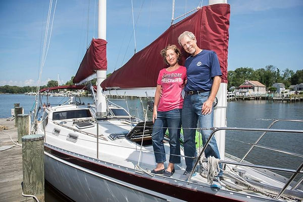 Greg and his wife on their sailboat, imge credit: Daily Herald